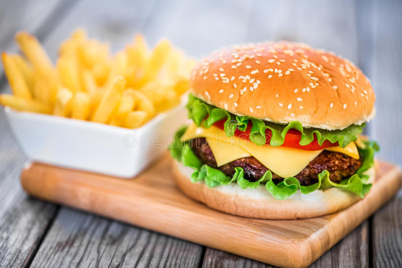 Burger. Tasty and appetizing hamburger cheeseburger royalty free stock photography