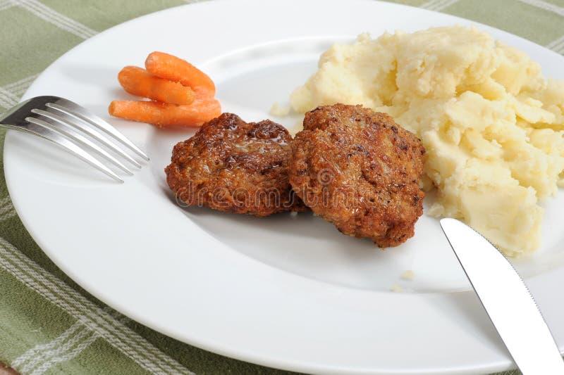 Burger und gestampfte Kartoffel stockfoto