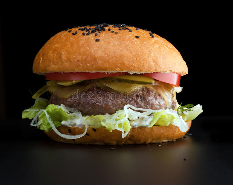 Burger, white bun with one cutlet royalty free stock photo