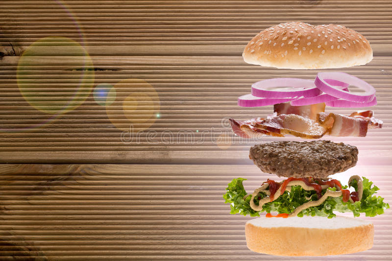 Burger with wooden background stock photos