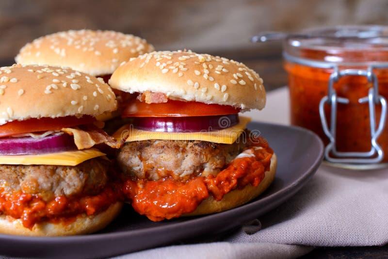 Burgers with ajvar salad. Mini beef burgers stuffed with ajvar salad,selective focus stock photos