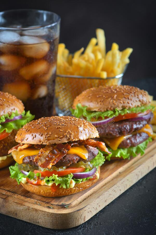 Burgers with fries. And a glass of Cola stock image