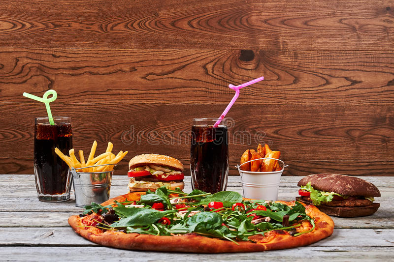 Burgers, fries and soda. Pizza and hamburgers. History of fast food stock photo