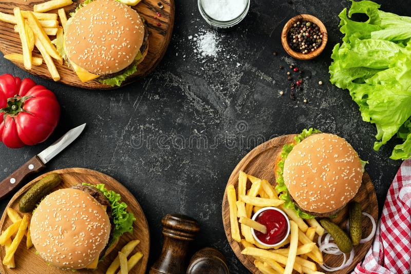 Burgers, hamburgers, french fries and fresh vegetables. BBQ party food stock images