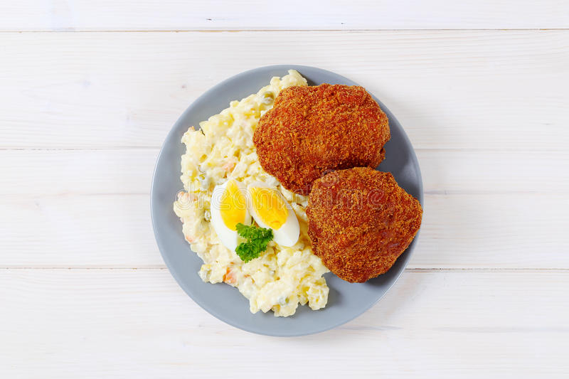 Download Burgers with potato salad stock image. Image of view - 83706503