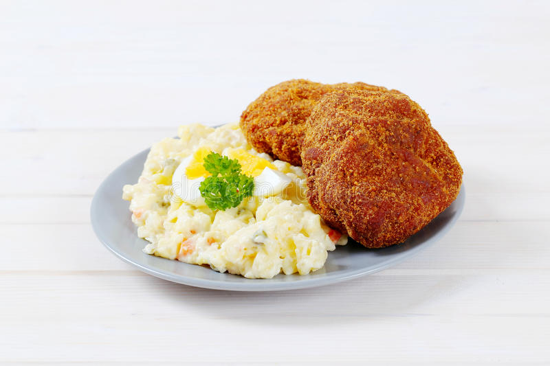 Download Burgers with potato salad stock photo. Image of fried - 83706884