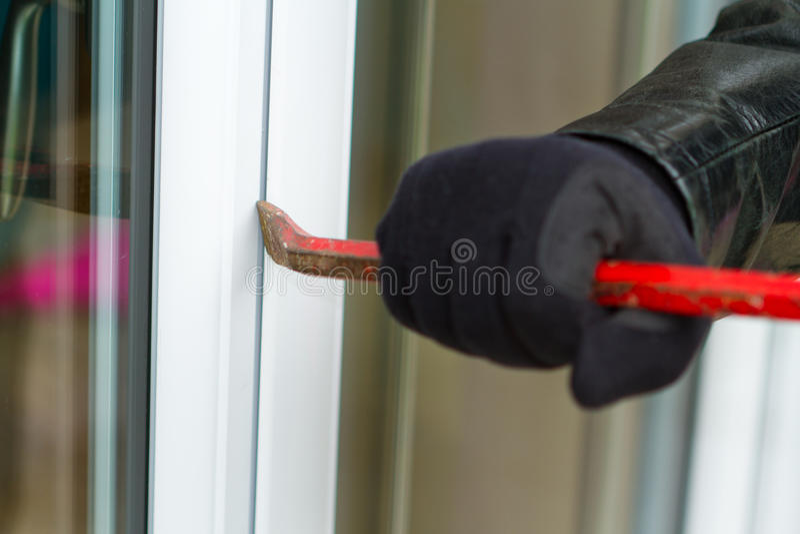 Burglar breaking in a house stock illustration