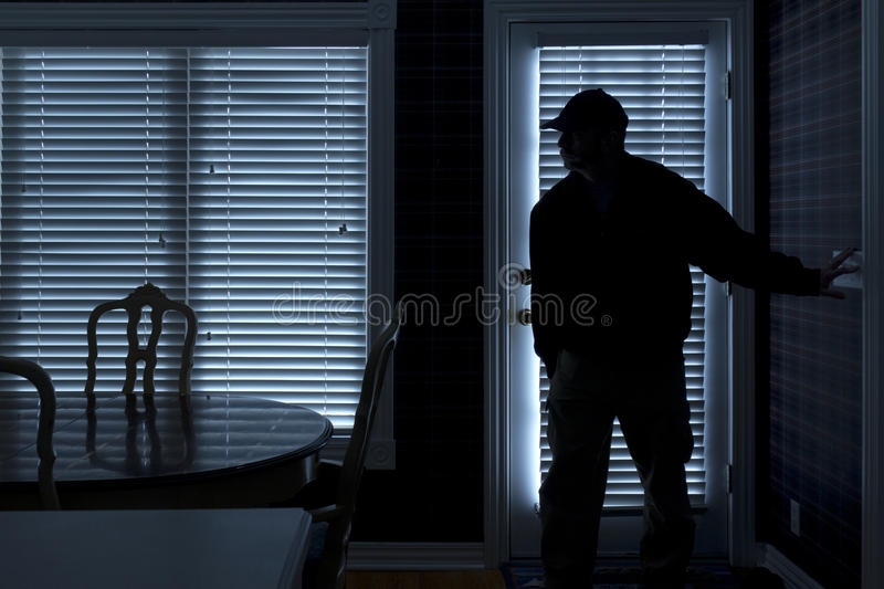 Burglar Breaking In To Home At Night Through Back royalty free stock images