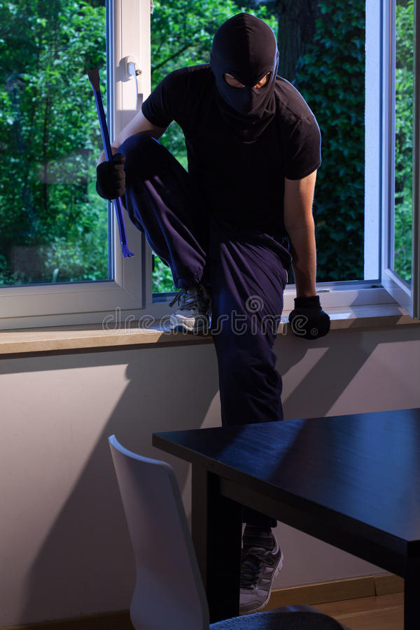 Burglar enters of someone's house stock photography