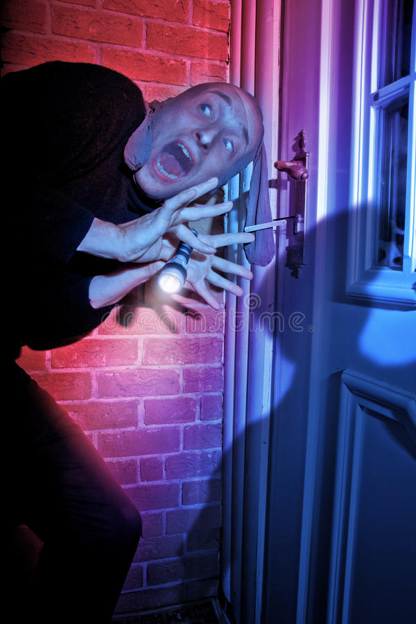 Download Burglar Getting Caught By Door Stock Image - Image of flashlight, surprised: 13545551