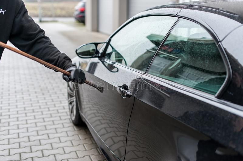 Burglar with gloves try to open a car stock photos