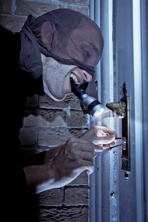 Download Burglar picking door lock stock image. Image of locked - 13545507