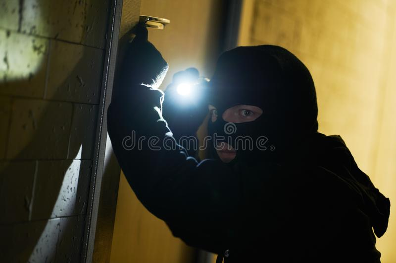 Burglar thief in mask. break-in of an apartment. royalty free stock photography
