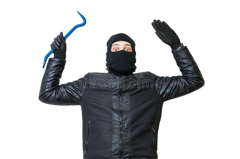 Burglar or thief is putting hands up. Arrested robber is giving up. Isolated on white background stock photography
