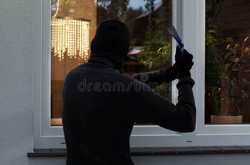 The burglar trying to break stock photo