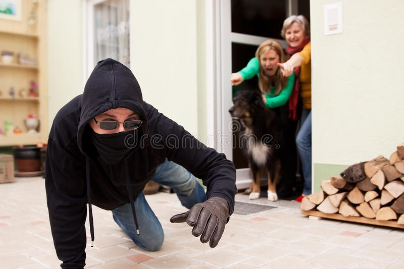 Burglars flee from the crime scene royalty free stock image