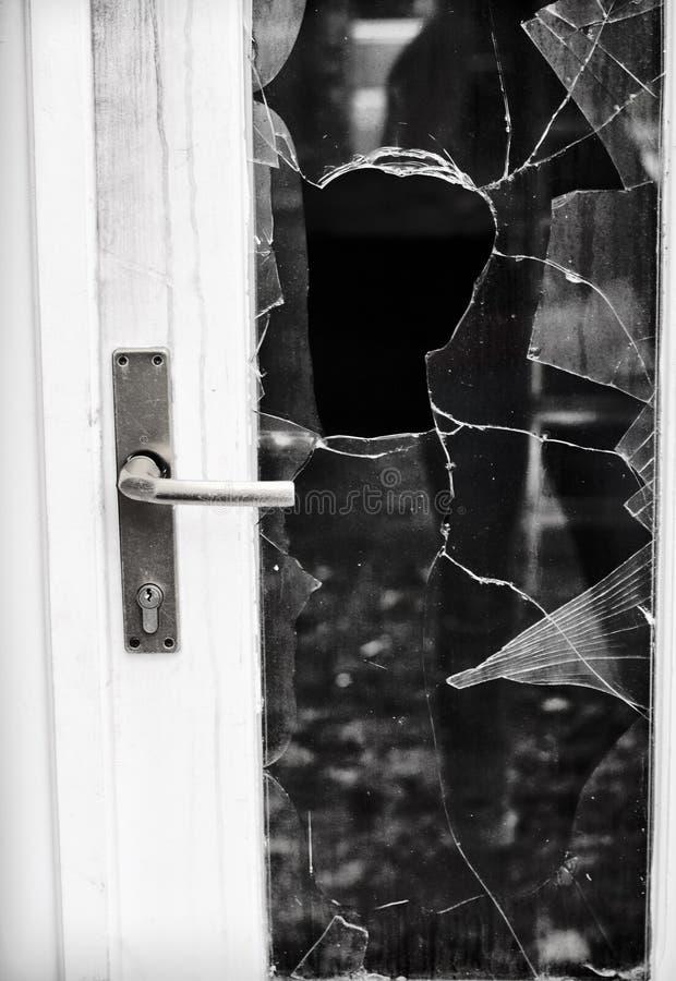 Burglary. Broken glass door after burglary stock photos