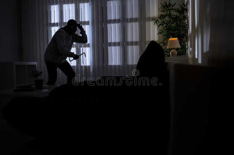 Burglary with crowbar breaking into a home royalty free stock photography