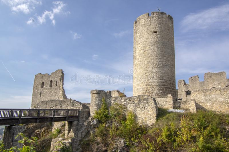 Burgruine Wolfstein old castle ruins with tower, blue sky. Burgruine Wolfstein old historic castle ruins with tower, blue sky and sunlight royalty free stock photos