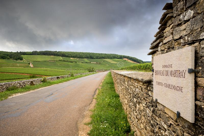 BURGUNDY - CORTON: scenic road that crosses the wine region near Corton. France. Burgundy, many chateau castle are surrounded by many acres of vineyards and are stock images