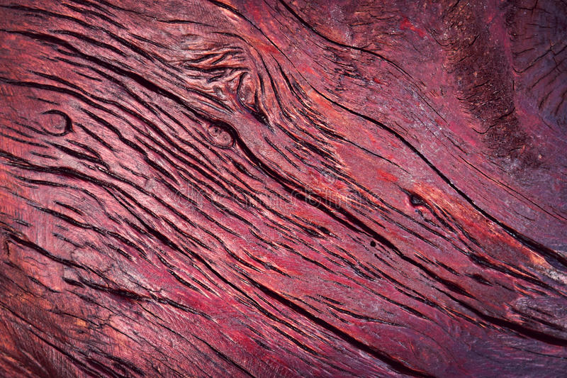 Burgundy painted wood with grooves stock image