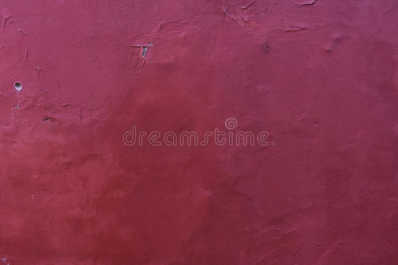 Burgundy wine background of old plaster. On the wall stock photos