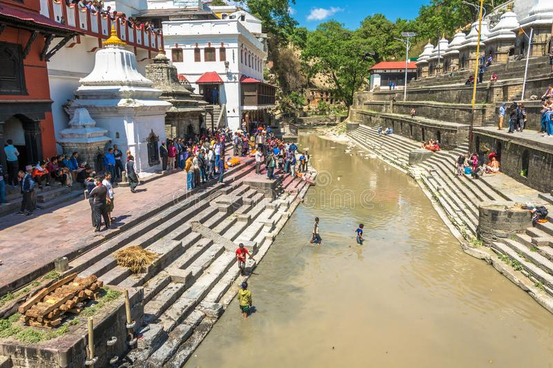 Burial ceremony on the banks of the Bagmati river in the Pashupa. Kathmandu, Nepal – 13.04.2018 Burial ceremony on the banks of the Bagmati river in the royalty free stock photography