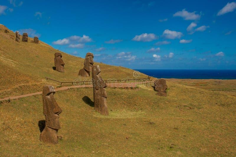 Buried Moais. View of Several Burried Moais at Rano Raraku Quarry on Rapa Nui stock photos
