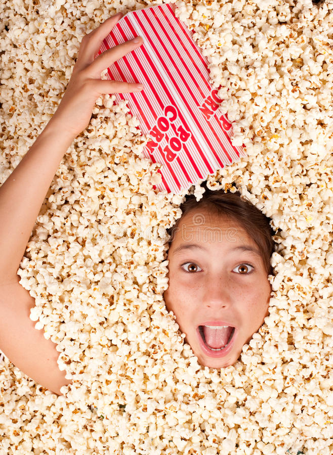 Download Buried in popcorn stock image. Image of colorful, background - 26576543