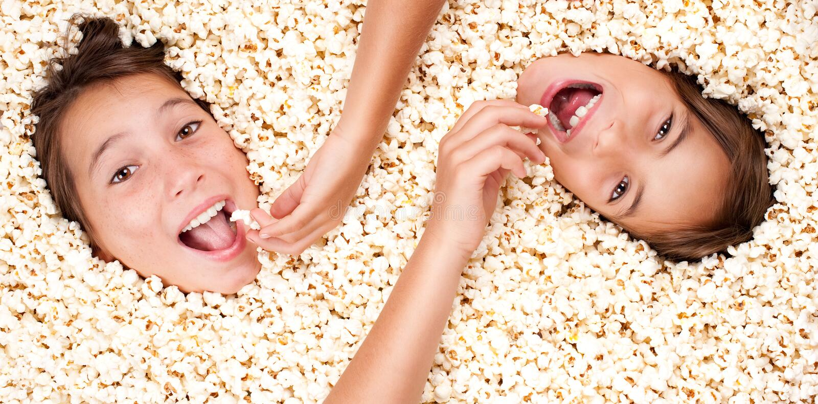 Download Buried in popcorn stock photo. Image of human, beautiful - 26576608
