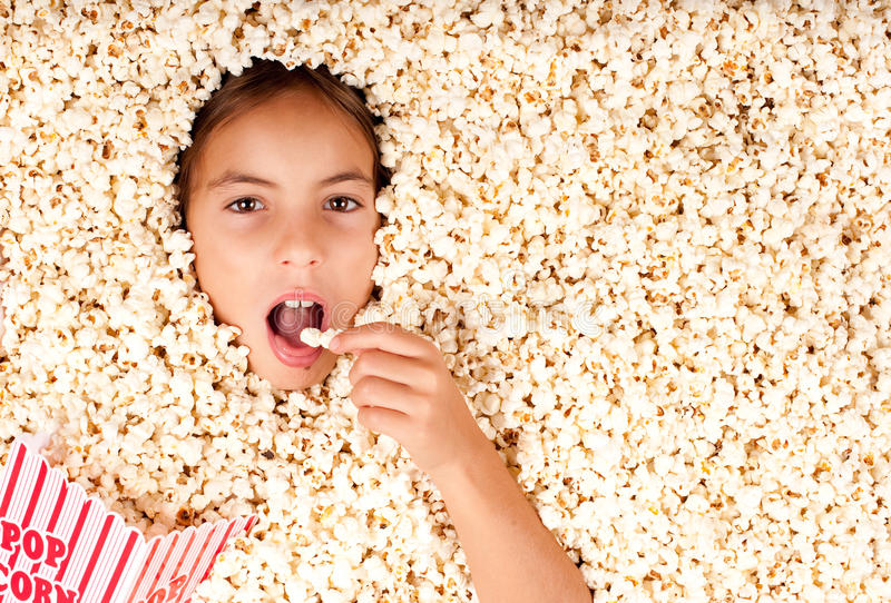 Download Buried in popcorn stock image. Image of movie, girl, motion - 26576627