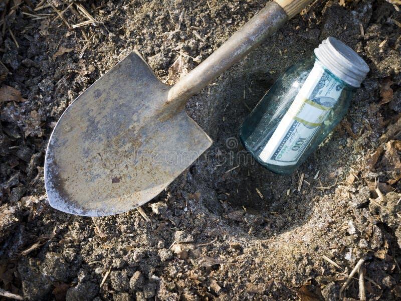 Buried Treasure - hiding money royalty free stock photo