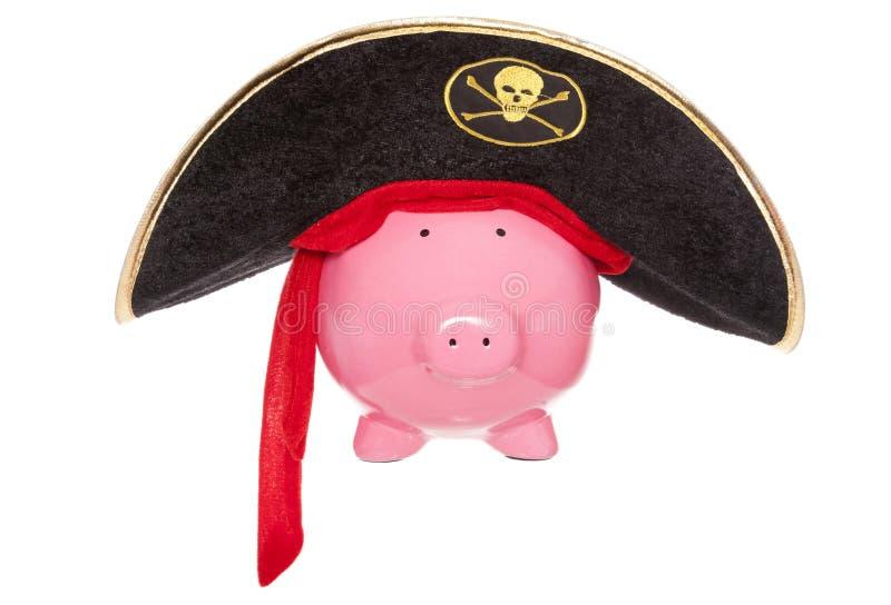 Buried treasure pirate piggy bank stock image
