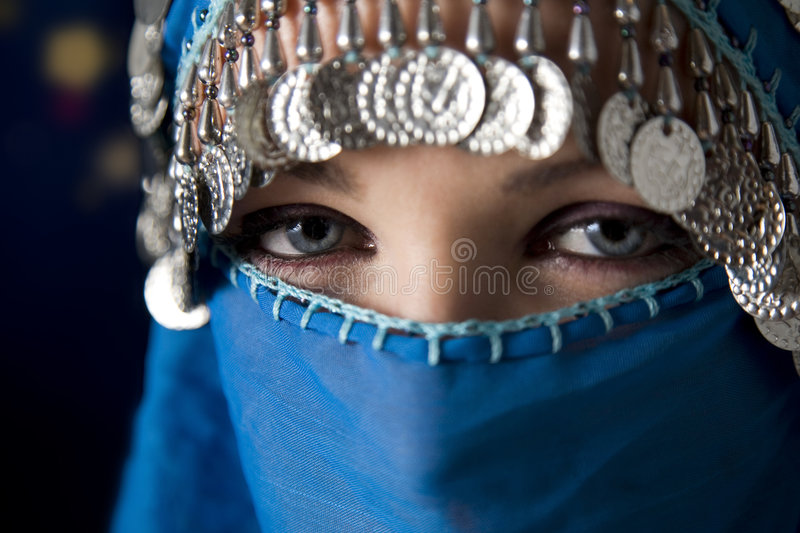 Burka. Middle eastern culture: belly dancer with traditional veil