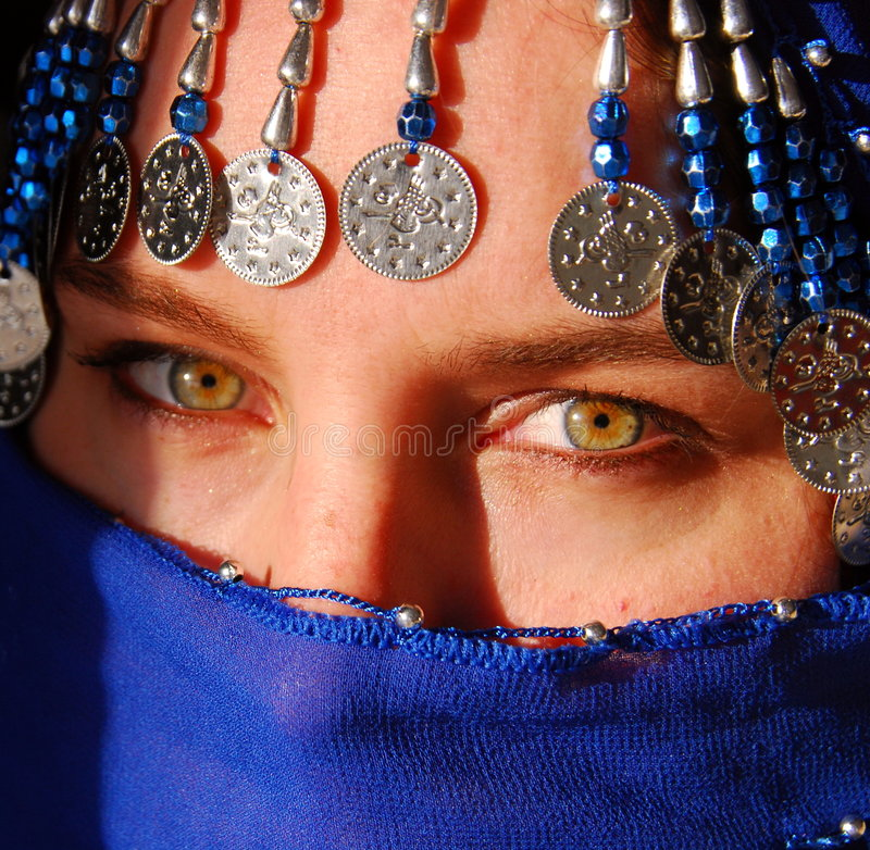 Burka. A green eyed woman with an intense look is hidden behind a burka royalty free stock images