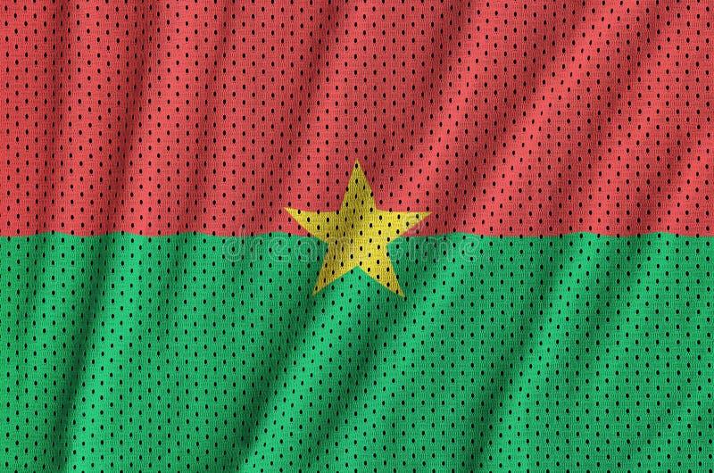 Burkina Faso flagga som skrivs ut på ett ingrepp f för polyesternylonsportswear royaltyfria bilder