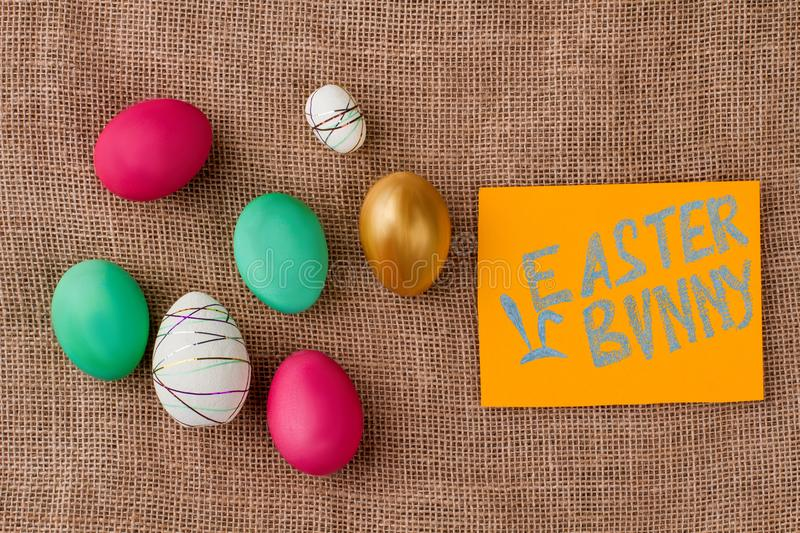 Burlap background with Easter festive eggs. royalty free stock photos