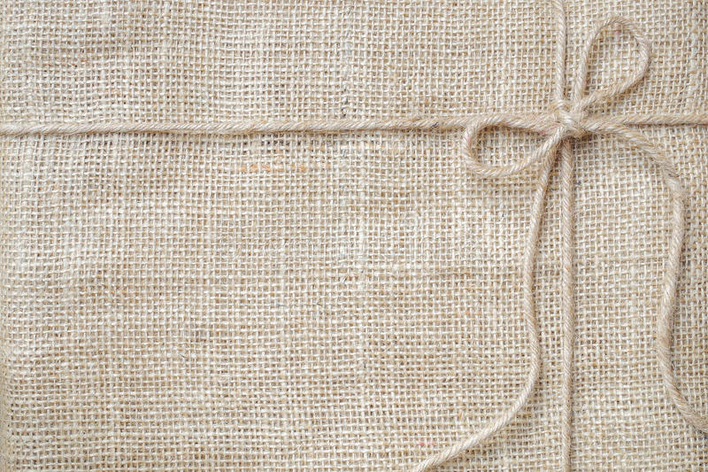 Burlap background tie with rustic burlap twine, natural product royalty free stock photo