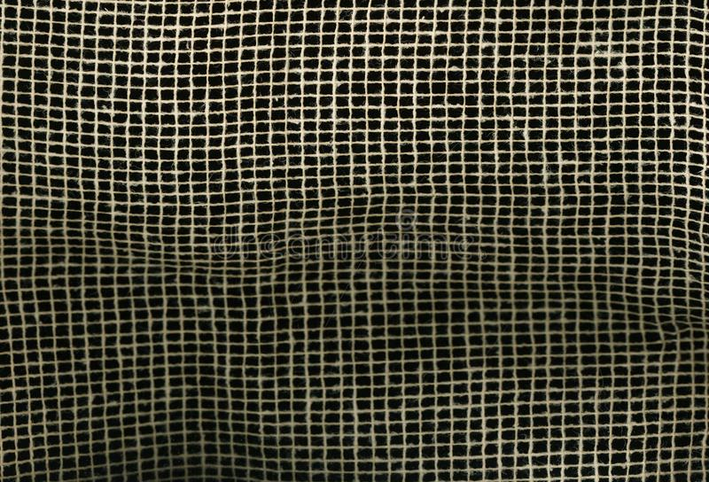 Textureof fabric Burlap Canvas Natural Brown mesh on black background. macro texture pattern background. royalty free stock photography