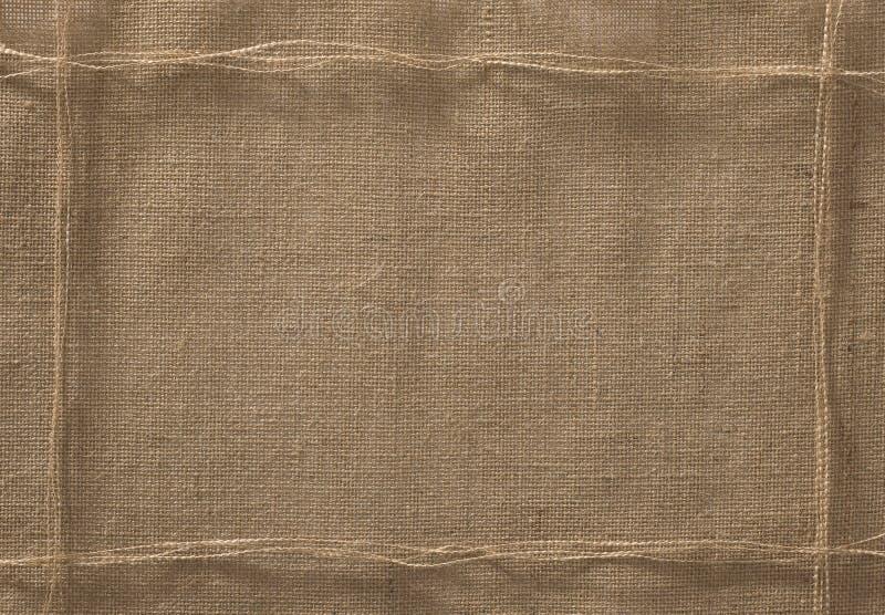 Burlap Fabric Frame Background, Sack Cloth Rope Thread royalty free stock photo