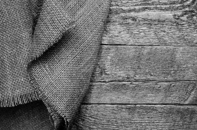 Burlap Fabric and Wood Texture Abstract. An abstract image of burlap fabric and old wood texture royalty free stock photo