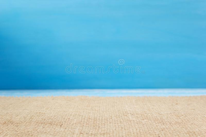 burlap hessian sacking cloth on wooden background stock photography