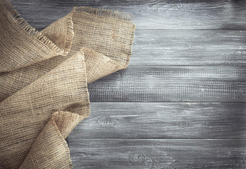 Burlap hessian sacking on wood. En background stock photos