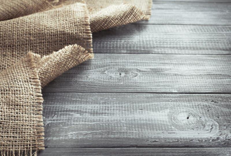 Burlap hessian sacking on wood. En background stock photo