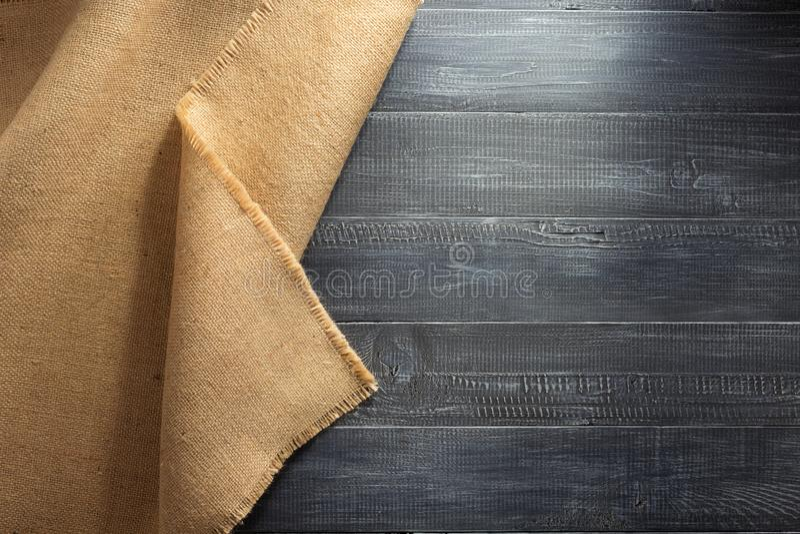 Burlap hessian sacking on wood. En background stock photography