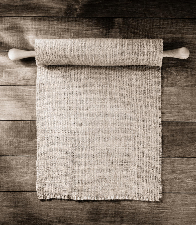 Burlap hessian sacking on wooden. Background stock image