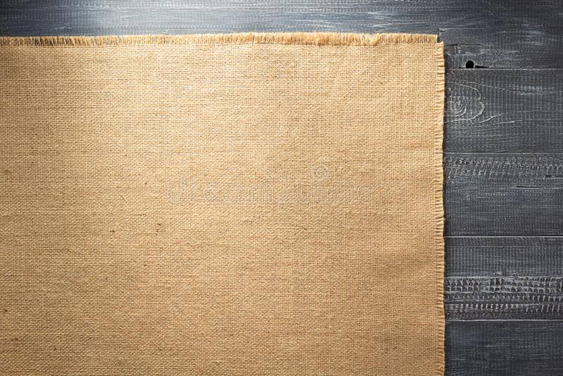 Burlap hessian sacking on wood. En background stock image
