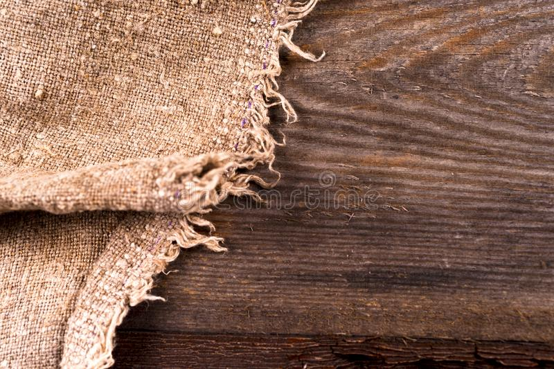 Burlap hessian sacking on wooden background. Grunge vintage backdrop. Copy space for text royalty free stock photos