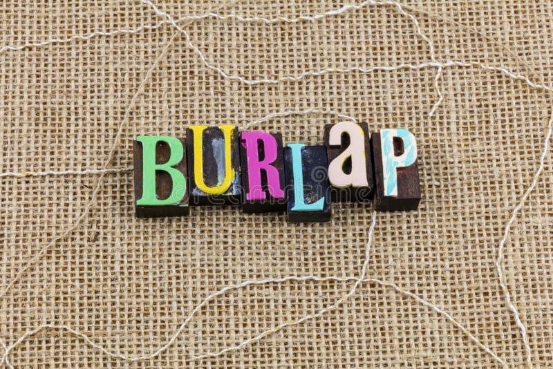 Burlap jute cloth background letterpress wood block letters word stock photos