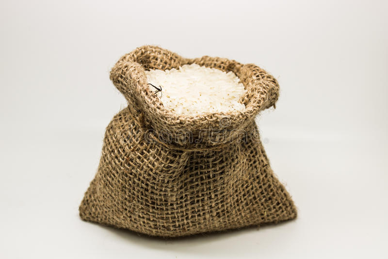 Burlap sack of rice royalty free stock image